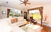 Family room - Single Family Home for sale at 571 Khyber Ln, Venice, FL 34293 - MLS Number is A4210343