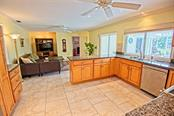 Kitchen/Family room combo - Single Family Home for sale at 600 Wild Turkey Ln, Sarasota, FL 34236 - MLS Number is A4210585