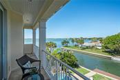 Terrace off Master bedroom with views of canal and bay/Intracoastal - Single Family Home for sale at 1503 Blue Heron Dr, Sarasota, FL 34239 - MLS Number is A4212851