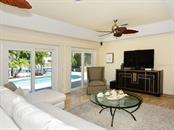 Family Room Overlooking Pool - Single Family Home for sale at 85 S Polk Dr, Sarasota, FL 34236 - MLS Number is A4400870