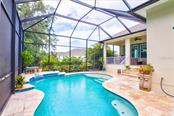 Pool has Pebble-Tec surface and water feature. - Single Family Home for sale at 8139 37th Avenue Cir W, Bradenton, FL 34209 - MLS Number is A4404272