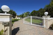 Private, automatic gate entrance - Single Family Home for sale at 1778 Bayshore Dr, Englewood, FL 34223 - MLS Number is A4405962