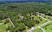 Fabulous 6.4 acres of land with three pastures wrapping around each side of the home - making it easy to see your animals or the deer enjoying themselves right from the comfort of home. - Single Family Home for sale at 7866 Saddle Creek Trl, Sarasota, FL 34241 - MLS Number is A4407172
