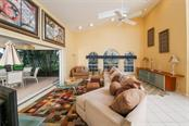 Living Room opens to Lanai - Villa for sale at 4472 Calle Serena, Sarasota, FL 34238 - MLS Number is A4407721