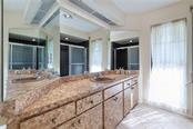 Second bathroom - Single Family Home for sale at 6661 Gulf Of Mexico Dr, Longboat Key, FL 34228 - MLS Number is A4410988