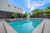 Community pool & patio area - Condo for sale at 1255 N Gulfstream Ave #1502, Sarasota, FL 34236 - MLS Number is A4413205