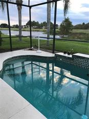 Looking toward the pond, which is part of the golf course. - Villa for sale at 252 Fairway Isles Ln, Bradenton, FL 34212 - MLS Number is A4417217