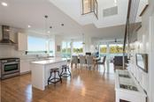 Open floor plan - Single Family Home for sale at 7130 Longboat Dr E, Longboat Key, FL 34228 - MLS Number is A4418105