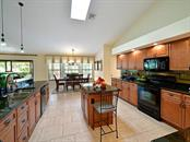 Eat in space and an island this kitchen lives large! - Single Family Home for sale at 9902 Braden Run, Bradenton, FL 34202 - MLS Number is A4419792