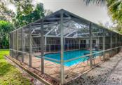 A view of the pool and lanai gives you a sense of the roomy outdoor space. - Single Family Home for sale at 1509 Flower Dr, Sarasota, FL 34239 - MLS Number is A4421898