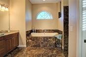 Jacuzzi tub with separate shower stall - Single Family Home for sale at 29425 Saddlebag Trl, Myakka City, FL 34251 - MLS Number is A4422648