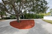 The end of the long driveway is circles around the big tree for convenience and extra parking. - Single Family Home for sale at 6213 8th Avenue Dr W, Bradenton, FL 34209 - MLS Number is A4423560