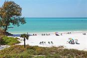 Best of all, Whispering Sands owners enjoy 800' of their own beach on the Gulf of Mexico! - Condo for sale at 225 Hourglass Way #208, Sarasota, FL 34242 - MLS Number is A4425323