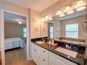 Master bathroom and bedroom. - Single Family Home for sale at 2558 Oneida Rd, Venice, FL 34293 - MLS Number is A4428145