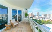 Living room and terrace - Condo for sale at 100 Central Ave #f1014, Sarasota, FL 34236 - MLS Number is A4428676
