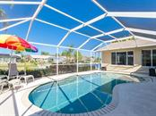 Pool has been resurfaced, as well as cage and screens well maintained - Single Family Home for sale at 4908 Coral Lake Dr, Bradenton, FL 34210 - MLS Number is A4431516
