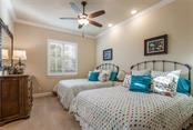 The large second bedroom accommodates two queen sized beds and has recessed lighting. - Single Family Home for sale at 19432 Newlane Pl, Bradenton, FL 34202 - MLS Number is A4432094