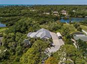 Aerial - almost 2 acres of lush tropical landscaping - meticulously maintained. - Single Family Home for sale at 1361 Bayshore Dr, Englewood, FL 34223 - MLS Number is A4433943
