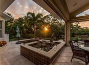 Spa, pool at sunset - Single Family Home for sale at 1361 Bayshore Dr, Englewood, FL 34223 - MLS Number is A4433943