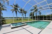 Spa and pool overlooks the lake - Single Family Home for sale at 5082 47th St W, Bradenton, FL 34210 - MLS Number is A4435806