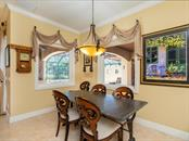 Breakfast Nook over looking the pool and kitchen - Single Family Home for sale at 158 Puesta Del Sol, Osprey, FL 34229 - MLS Number is A4439362