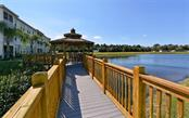Community gazebo overlooking pond to take in the sunsets! - Condo for sale at 200 San Lino Cir #233, Venice, FL 34292 - MLS Number is A4440138