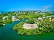 Vacant Land for sale at 724 Hideaway Bay Ln, Longboat Key, FL 34228 - MLS Number is A4441068