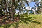 Single Family Home for sale at 600 Marbury Ln, Longboat Key, FL 34228 - MLS Number is A4446401