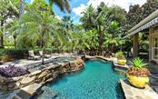 Lucas Lagoons designed pool with waterfalls. - Single Family Home for sale at 586 N Macewen Dr, Osprey, FL 34229 - MLS Number is A4451482