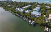 Deeded boat dock on right of large boat. - Condo for sale at 3994 Hamilton Club Cir #18, Sarasota, FL 34242 - MLS Number is A4455281