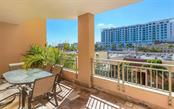 Oversized tiled terrace brings in a lot of light - Condo for sale at 100 Central Ave #A304, Sarasota, FL 34236 - MLS Number is A4458873