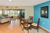 Dinette to family room - Single Family Home for sale at 1758 Croton Dr, Venice, FL 34293 - MLS Number is A4459877