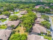 Aerial view of Center Gate Estates Village 1 - Villa for sale at 4335 Rum Cay Cir, Sarasota, FL 34233 - MLS Number is A4463762