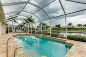 Pool with water view - Single Family Home for sale at 4338 Corso Venetia Blvd, Venice, FL 34293 - MLS Number is A4467578