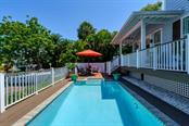 Saltwater pool and outdoor terrace - Single Family Home for sale at 605 N Point Dr, Holmes Beach, FL 34217 - MLS Number is A4469001