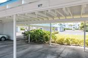 Covered carport. - Condo for sale at 977 Sandpiper Cir #977, Bradenton, FL 34209 - MLS Number is A4474554
