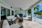 First floor patio, pool to right. - Single Family Home for sale at 718 Key Royale Dr, Holmes Beach, FL 34217 - MLS Number is A4480381
