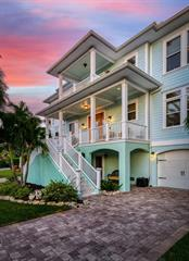 Evening front view. - Single Family Home for sale at 718 Key Royale Dr, Holmes Beach, FL 34217 - MLS Number is A4480381