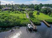 Aerial - Dock / Boardwalk & Boat lift - Single Family Home for sale at 1395 Bayshore Dr, Englewood, FL 34223 - MLS Number is A4480508