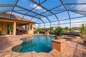 Looking across the pool to the Veranda. - Single Family Home for sale at 11720 Rive Isle Run, Parrish, FL 34219 - MLS Number is A4486302