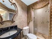 Gorgeous guest bathroom with spectaular shower. - Condo for sale at 14021 Bellagio Way #407, Osprey, FL 34229 - MLS Number is A4487552