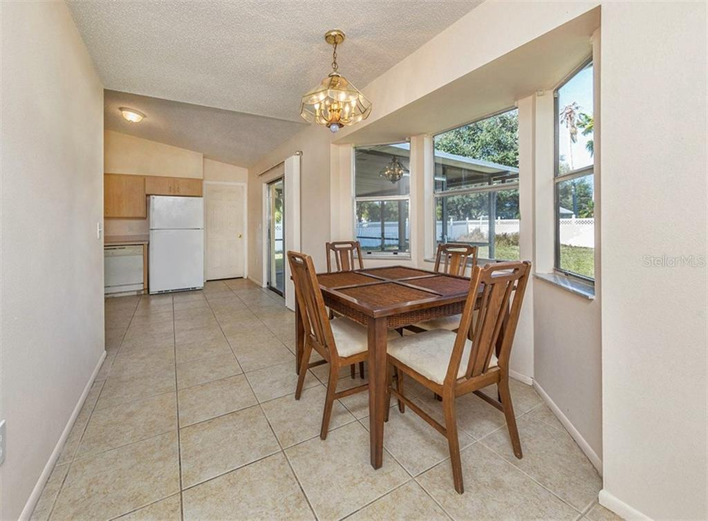 Dining Room/Kitchen - Single Family Home for sale at 10308 Grail Ave, Englewood, FL 34224 - MLS Number is N5911429