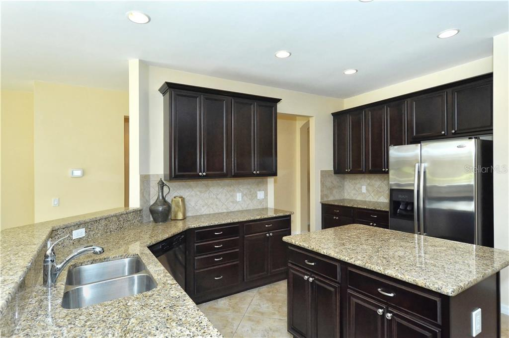 Kitchen - Single Family Home for sale at 19168 Jalisca St, Venice, FL 34293 - MLS Number is N5912651