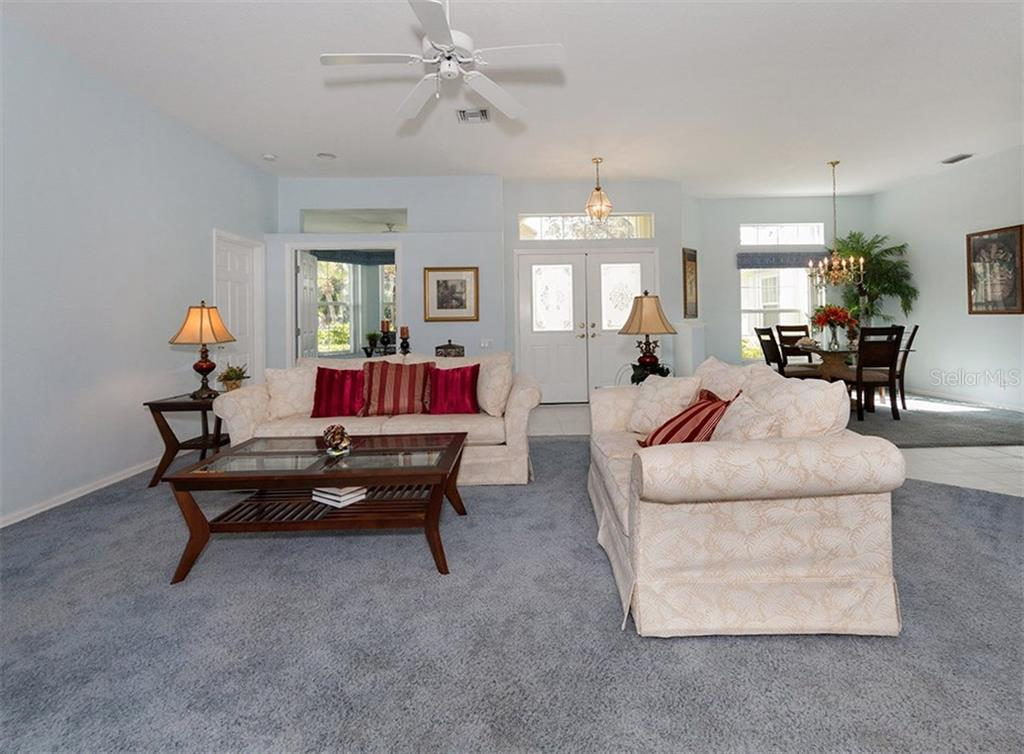 Living room to lanai - Single Family Home for sale at 2122 Timucua Trl, Nokomis, FL 34275 - MLS Number is N5913111