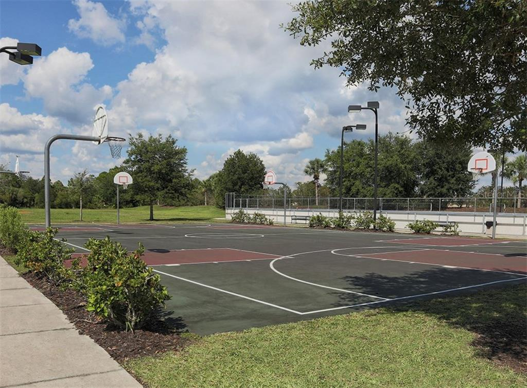 Basketball courts and in-line skating rink - Single Family Home for sale at 11759 Puma Path, Venice, FL 34292 - MLS Number is N5913611
