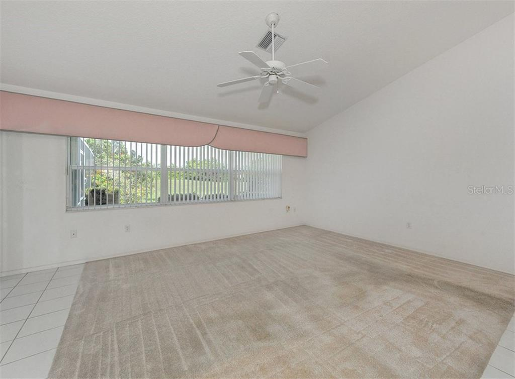 Family room - Single Family Home for sale at 683 May Apple Way, Venice, FL 34293 - MLS Number is N5913909