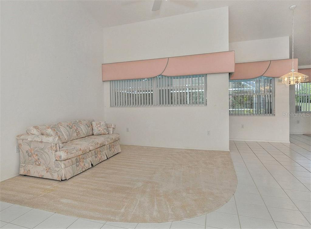 Living room/dinette - Single Family Home for sale at 683 May Apple Way, Venice, FL 34293 - MLS Number is N5913909