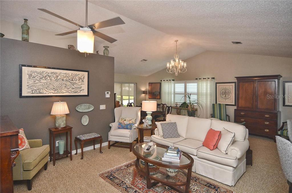 Living room to dining room - Single Family Home for sale at 1812 Ashley Dr, Venice, FL 34292 - MLS Number is N5914047