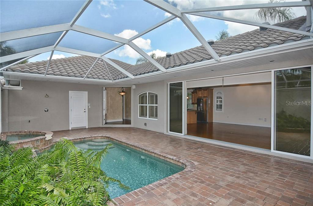 Pool to living room/dining room - Single Family Home for sale at 248 Pensacola Rd, Venice, FL 34285 - MLS Number is N5914299