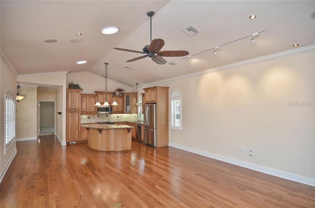 Living room, kitchen, dining room - Single Family Home for sale at 248 Pensacola Rd, Venice, FL 34285 - MLS Number is N5914299
